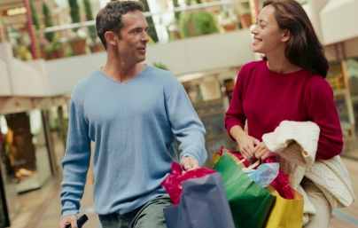 Couple Carrying Shopping Bags in Mall